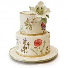 Торт свадебный в два яруса, с узорами по бокам торта и большим белым цветком сбоку