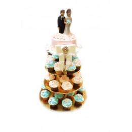 Торт свадебный нежно-розовый с голубыми и розовыми капкейками