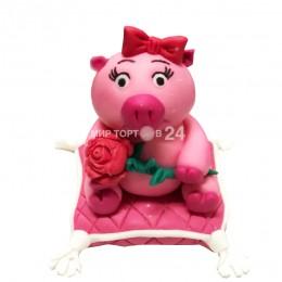 Фигурка розовая Свинка на подушке